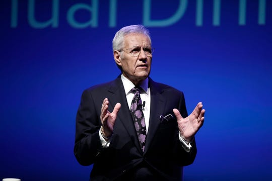 """In this Oct. 1, 2018, file photo, moderator Alex Trebek speaks in Hershey, Pa. """"Jeopardy!"""" and """"Wheel of Fortune"""" will tape without studio audiences in response to the ongoing virus outbreak, a person close to the shows tells the Associated Press, Monday, March 9, 2020."""