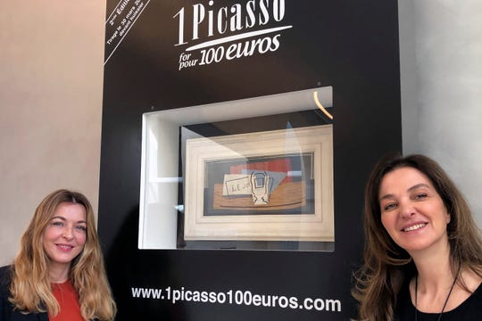 """Art historian Arabelle Reille, left, and television producer Peri Cochin pose in the Picasso Museum in Paris, in front of """"Nature Morte."""" The still life that Picasso painted in 1921 is being raffled off for charity in Paris this month with tickets at 100 euros each."""