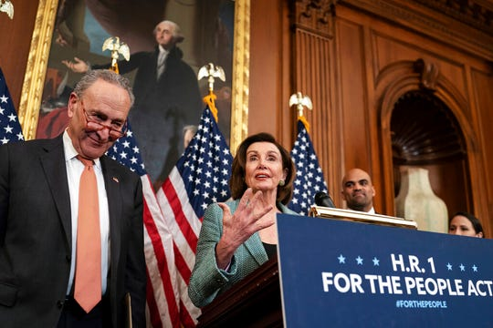 "Senate Minority Leader Chuck Schumer, D-N.Y., left, and Speaker of the House Nancy Pelosi, D-Calif., call on Senate Majority Leader Mitch McConnell, R-Ky., to bring the Democrats' HR-1 ""For the People Act"" to the floor for a vote, during an event on Capitol Hill in Washington, Tuesday, March 10, 2020."