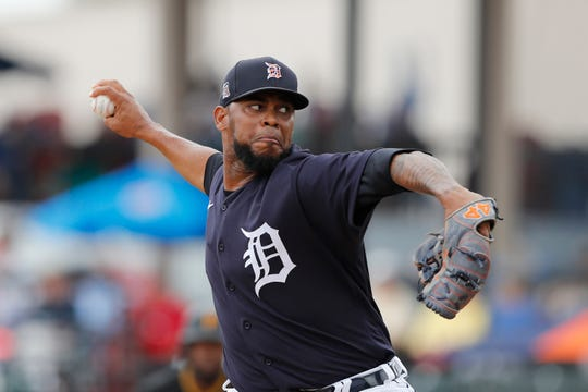 Tigers relief pitcher Jose Cisnero throws during the game against the Pirates.