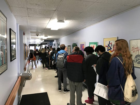 Dozens of Michigan State University students waited more than an hour Tuesday afternoon to register to vote in East Lansing for the state's presidential primary.