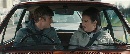 "Barry Ward and Maeve Higgins in ""Extra Ordinary."""