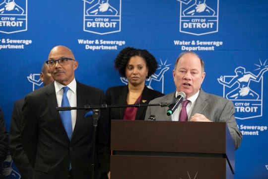 (From left) Gary Brown, Director of the Detroit Water and Sewerage Department, Denise Fair, Chief Public Health Officer of the Detroit Health Department, and Detroit Mayor Mike Duggan hold a press conference at the Detroit Water and Sewerage department, March 9, 2020.