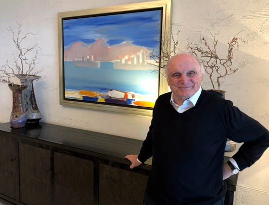 David Nahmad poses in front of a seascape by artist Nicolas de Stael in Nahmad's home in Monaco. Nahmad has spent decades accumulating what he believes is now the world's largest private collection of works by Pablo Picasso, but he is about to part with one of them. A still life that Picasso painted in 1921 is being raffled off for charity.