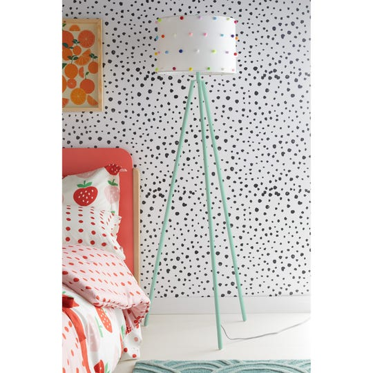 Wallpaper with black polka dots is another fun to introduce this color combo.