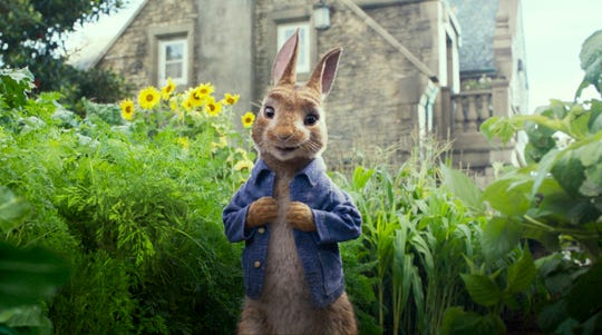 """This image released by Columbia Pictures shows Peter Rabbit, voiced by James Corden and Cottontail in a scene from """"Peter Rabbit."""" Sony Pictures announced Tuesday, March 10, 2020 that it's moving the release date for """"Peter Rabbit 2"""" to Aug. 7 as Hollywood continues to shuffle its upcoming releases due to the coronavirus."""