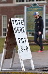 A voter leaves Defer Elementary School in Grosse Pointe Park, Tuesday morning, March 10, 2020.