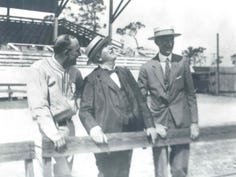Lee County winter resident Thomas Edison, center watches a  fly ball between future baseball Hall of Fame members Ty Cobb and Connie Mack in this 1927 photo. The first  spring training game in the county was played 95 years ago Thursday, and over the years has helped bring in millions of tourist dollars.