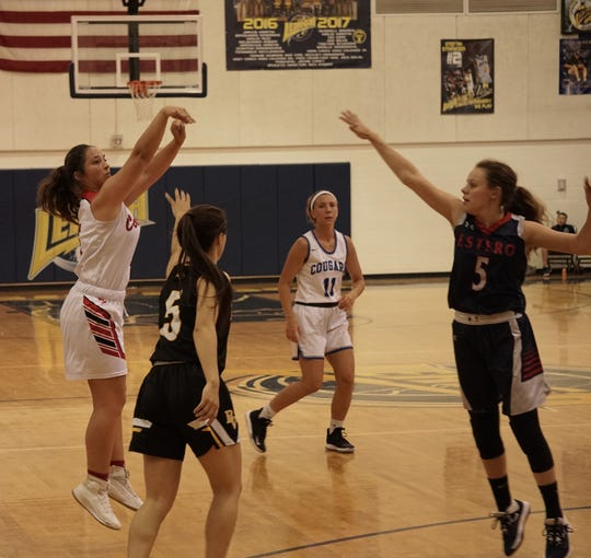 Estero's Chrissy Mackie closes out on LaBelle's Taylor Sanchez' 3-point attempt during Monday's SFABC Senior All Star Game at Lehigh High School.