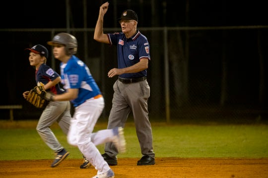 Bill Dunn (center) umpires his 2,800th youth baseball game on March 6, 2020, in Bonita Springs. Shortly after the game all youth sports leagues shutdown in the wake of the coronavirus.