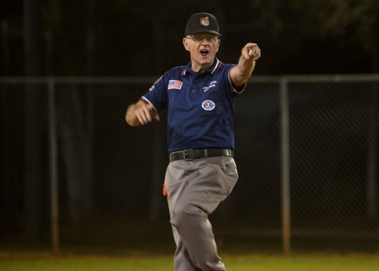 Bill Dunn calls a player out during his 2800th little league game on Friday, March 6, 2020, in Bonita Springs.
