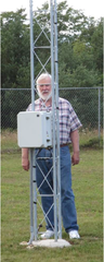 Liberty Grove Technology Committee Chair David Studebaker compares the size of a wireless tower base to show how small they are compared to cellular towers.
