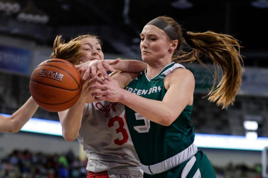 IUPUI forward Morgan Allen and UWGB guard Frankie Wurtz, right, go for a loose ball in the first half of the Horizon League tournament championship game Tuesday.
