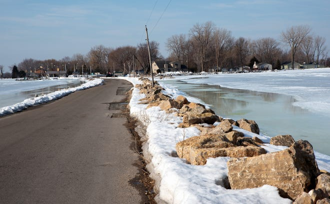 A view of the shoreline on March 7 from the causeway extending into the Bay of Green Bay from Breakwater Park at Oconto on the left and private homes on the right, shows the hi level of the water.