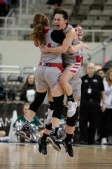IUPUI guard Holly Hoopingarner, right, jumps into the arms of guard Rachel McLimore after they defeated UWGB 51-37 in the Horizon League tournament championship game in Indianapolis.