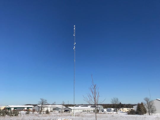 A narrow fixed wireless broadband tower outside of Door County Broadband's Baileys Harbor office. The company installs similar towers along the peninsula, but has been unable to reach some rural areas due to a county ordinance some are pushing to change.