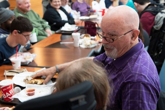 """Robert """"Skeeter"""" Powell eats lunch at Haywood Mall with members of David's Table in Greenville Wednesday, Mar. 4, 2020."""