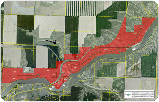 """The Planning Commission will study rezoning land north of the Missouri River, indicated in red. Currently, the predominant use of the land is hydroelectric dams, but the land is improperly zoned """"open space."""""""