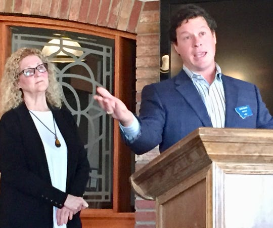 Matt Rains, candidate for House District 22, speaks Tuesday to Cascade County Democrats. Sen. Carlie Boland, D-Great Falls, lookson.