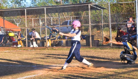 Academy of Our Lady of Guam batter Erin Williams with the winning RBI single that scored Aja Stone as the Cougars eliminated the Guam High Panthers in DOE Interscholastic Sports Association softball playoffs March 10 at GW field. The Cougars won 14-4 in a 5-inning game shortened by mercy rule.