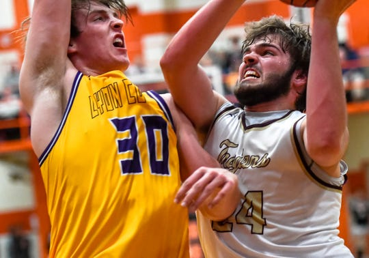 Webster County's Hunter McNaughton (24) drives to the rim against defense from Lyon County's Jackson Shoulders (30) as the Webster County Trojans play the Lyon County Lyons in the Second Region boys semifinals Monday evening at Hopkinsville High School, March 9, 2020.