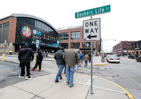 Ticket buyers and sellers advertise to fans outside Bankers life Fieldhouse before the NCAA Big Ten tournament in Indianapolis, Tuesday, March 10, 2020.