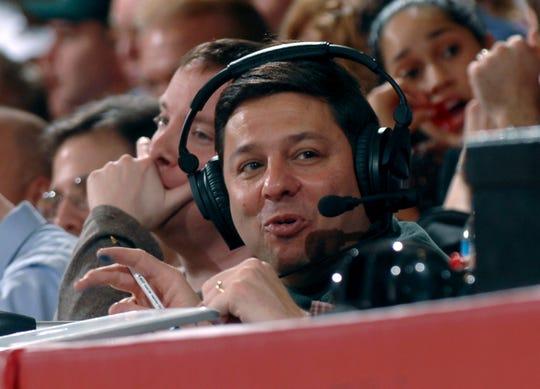 "Joe Lunardi, known as ""The Bracketologist,"" sits courtside during the men's basketball game between Saint Joseph's University and Duquense in Philadelphia, Jan. 3, 2007."