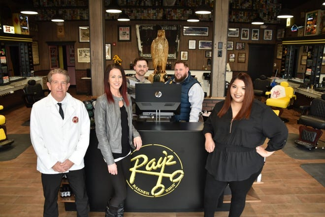 General Manager Chris Ontiveros (left) poses with the staff of Ray'z Barbershop's new Coralville location, open as of Feb. 29, 2020.