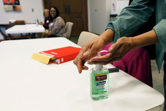 """A voter takes advantage of the hand sanitizer to """"clean up"""" after voting in the presidential party primary in Ridgeland, Miss., Tuesday, March 10, 2020. Polling locations are providing hand sanitizers for voters to use as a cautionary measure in light of the coronavirus health concern nationwide."""