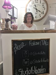 Christy Goranflo stands behind the homemade counter at her Studio 16 salon in February, 2020.