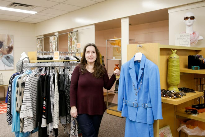 Suzanne Clemenz, Persimmon boutique manager, stands for a photo inside the new boutique for women at the YWCA of Greater Lafayette, Tuesday, March 10, 2020 in Lafayette.
