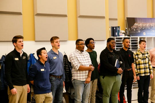 """Members of the Purdue and Morehouse College Glee Clubs rehearse before their evening performance, Tuesday, March 10, 2020 at Purdue University's Bailey Hall in West Lafayette. The concert as part of Purdue's """"Democracy, Civility, and Freedom of Expression"""" series."""