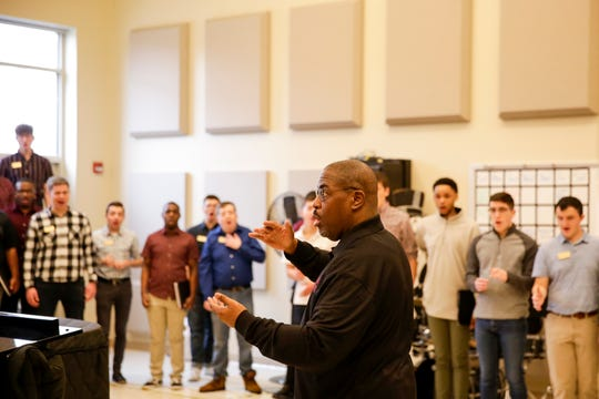 """Dr. David Morrow, director of the Morehouse College Glee Club, directs members of the Purdue and Morehouse College Glee Clubs rehearse before their evening performance, Tuesday, March 10, 2020 at Purdue University's Bailey Hall in West Lafayette. The concert as part of Purdue's """"Democracy, Civility, and Freedom of Expression"""" series."""