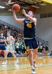 Hartland's Chase Ekonen takes the ball to the hoop in the Eagles' 62-54 loss to Howell in a district basketball game on Monday, March 9, 2020.