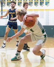 Howell's Peyton Ward scored nine of his 13 points in the fourth quarter of a 62-54 district basketball victory over Hartland on Monday, March 9, 2020.
