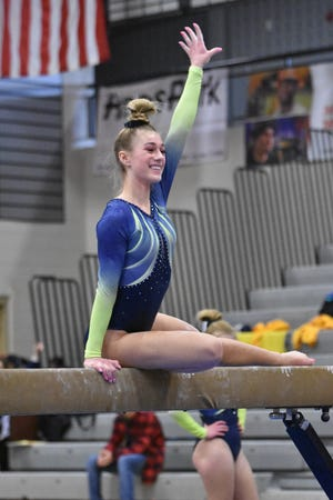 Ashlyn Shudick placed second all-around, leading Hartland to its first regional gymnastics championship since 1998.