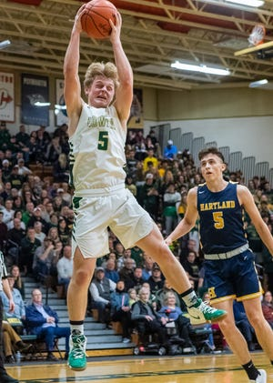 Howell's Peyton Ward hauls in a rebound during a 62-54 victory over Hartland in a first-round district basketball game on Monday, March 9, 2020.