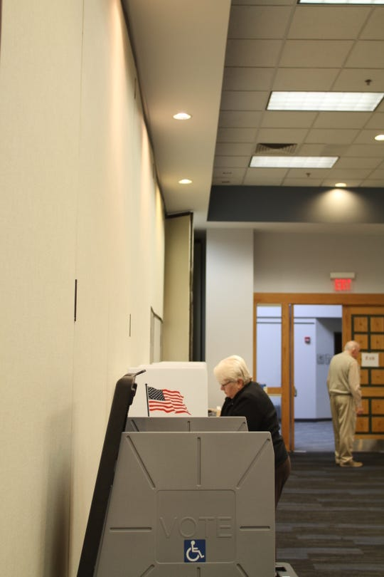 Howell resident Martha Towas casts her vote on on Tuesday, March 10, 2020 at Precinct 1 at Livingston Educational Service Agency in Howell.