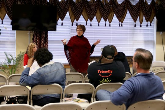 Jefferson County Property Valuation Administrator Colleen Younger, center, explains the property reassessment process during a meeting at Bates Memorial Baptist Church, 620 Lampton St.