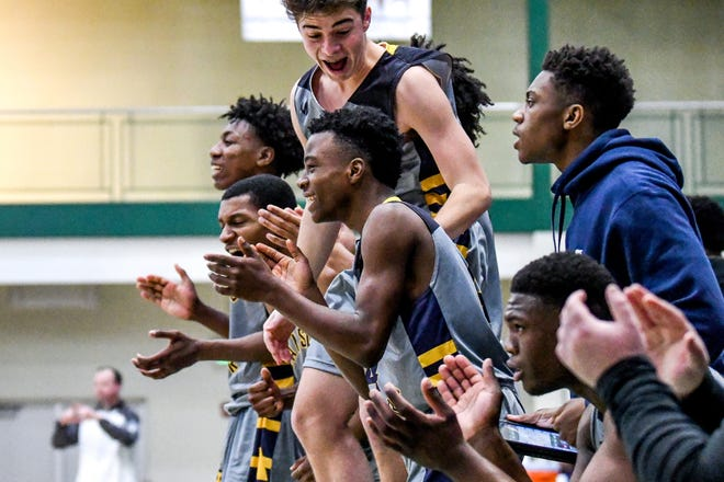 Eastern's team reacts to a favorable call during the second quarter on Monday, March 9, 2020, at Williamston High School.