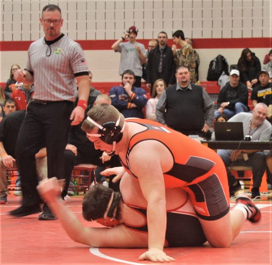 Crestview's Caden Hill, the projected state heavyweight champ, on the verge of pinning his opponent in the sectional finals at Plymouth