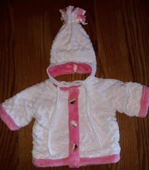 Baby Allison's new cap and coat, handmade by Lovina's daughter Elizabeth.