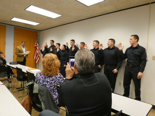 Marion Mayor Scott Schertzer, far left, swears in nine new firefighters. From left to right, the firefighters are Drew Shirk, Connor Sitz, Devin Hessler, Hannah Taha, Brady Watters, Tyler Lowe, Chad Townley, Dalton Adkins and Jonathan Seymour.
