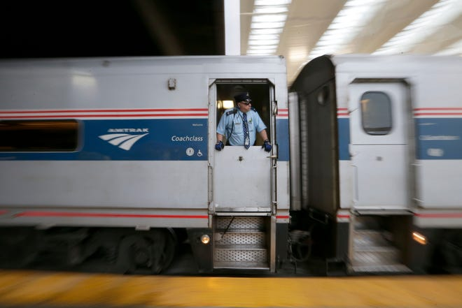 A conductor watches as the Amtrak Hiawatha line leaves the Milwaukee Intermodal train station.