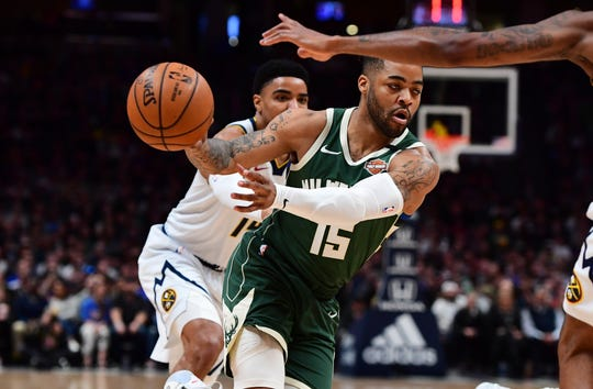 Bucks guard Frank Mason III passes to a teammate during the first quarter against the Nuggets.