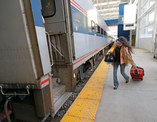 A woman boards the Amtrak Hiawatha line at the Milwaukee Intermodal train station on Monday, October 17, 2016.