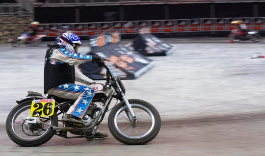 Chuck Dickinson, 79, gets some practice laps in during a media day event to promote the Flat Out Friday motorcycle races Tuesday, March 10, 2020 at the Fiserv Forum in Milwaukee. The flat track races, which were to be Friday, have been postponed.