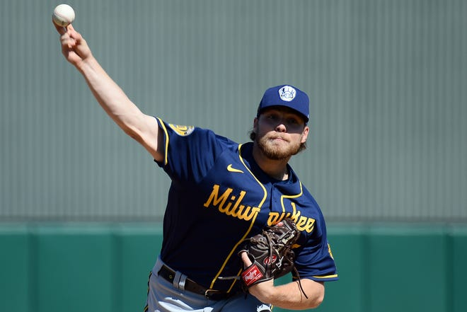 Corbin Burnes (shown in a spring training game earlier this year) retired all 12 batters he faced Wednesday night.