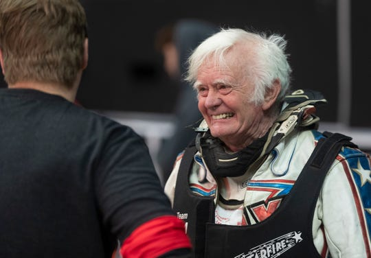 Chuck Dickinson, 79, talks to a younger competitor between some practice laps in during a media day event to promote the Flat Out Friday motorcycle races Tuesday, March 10, 2020 at the Fiserv Forum in Milwaukee. The flat track races, which were scheduled for Friday, have been postponed.