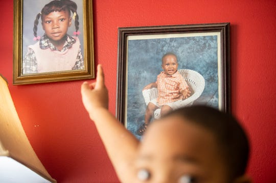 DeKarian Rollins points to a picture of his brother Chauncey Blackburn at their home in Montgomery, Ala., on Sunday, March 8, 2020. Chauncey Blackburn, 18, was shot and later died from his wounds on March 14, 2018. No one has been charged with his murder.